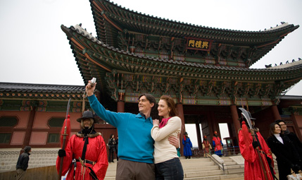 People are taking a photo in front of Gyeongbokgung Palace