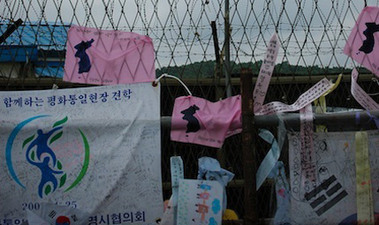 Korean flags are hanging on the wire fence